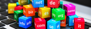 Macro view of group of color cubes with domain names on laptop or notebook keyboard with selective focus effect